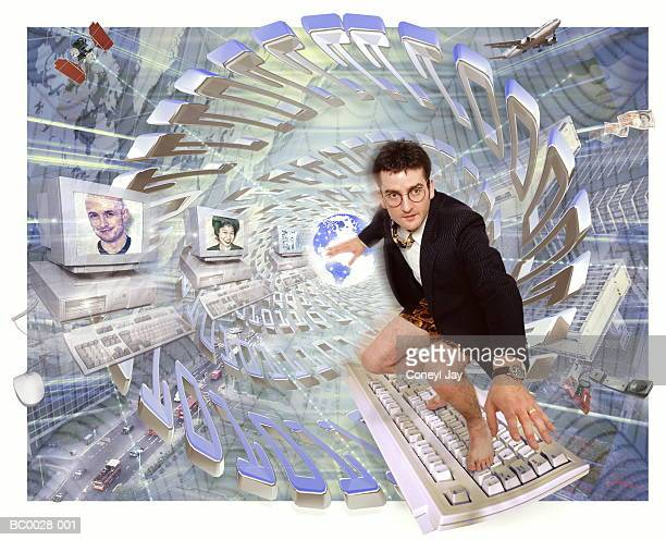 Global communications, businessman 'surfing' on keyboard (Composite)