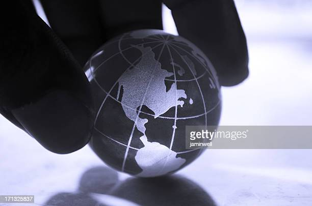 global concept; a firm dark hand in control of world