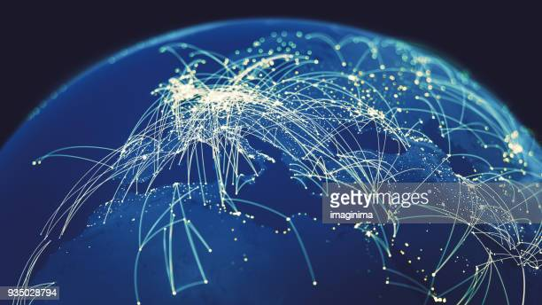 global connections (world map texture credits to nasa) - computer network stock pictures, royalty-free photos & images