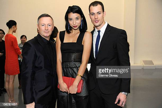 Global Creative Director of Calvin Klein Kevin Carrigan Fashion Blogger Lily Kwong and Jeremy O'Shea pose for pictures with a guest during the Calvin...
