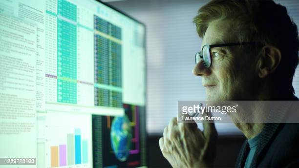 global data mature man - stock market stock pictures, royalty-free photos & images