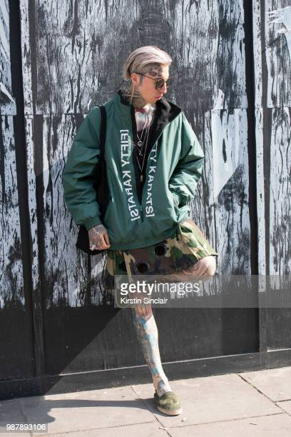 Global Digital director and model Chris Lavish wears Yohji Yamamoto sunglasses Fifty Karats jacket during London Fashion Week Men's on June 10 2018...