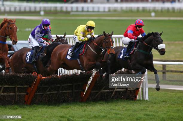 Global Fame ridden by C.Brace jumps a fence alongside Raashdy ridden by Jonathan England on their way to winning the Watch Racing TV In Stunning HD...