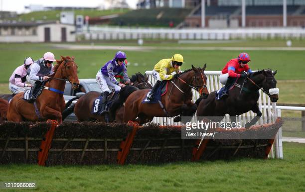 Global Fame ridden by CBrace jumps a fence alongside Raashdy ridden by Jonathan England on their way to winning the Watch Racing TV In Stunning HD...
