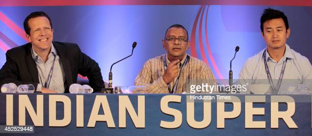 R global football vicepresident Andy Knee AIFF secretary Kushal Das and former Indian football captain Bhaichung Bhutia during the player draft of...