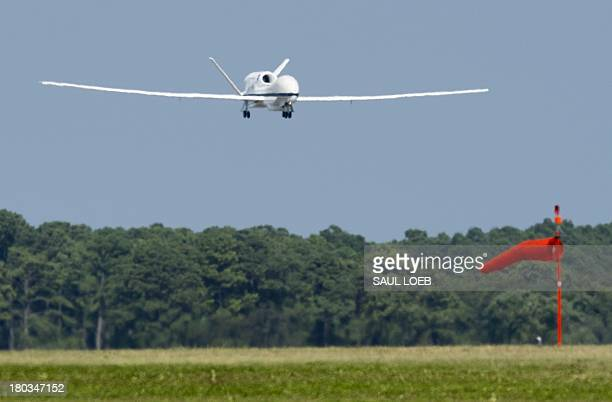 Global Hawk unmanned aerial vehicle or drone aircraft in flight during a Hurricane and Severe Storm Sentinel or HS3 mission at NASA's Wallops Flight...