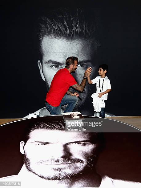 Global icon and footballing legend David Beckham high fives a fan as he opened the new adidas HomeCourt concept store in the Mall of Emirates Dubai...
