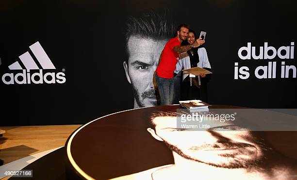 Global icon and footballing legend David Beckham pooses for a picture with a fan as he opened the new adidas HomeCourt concept store in the Mall of...