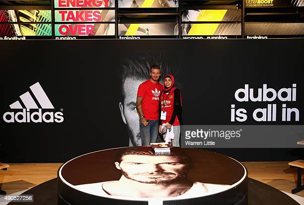 Global icon and footballing legend David Beckham poses for a picture with a fan as he opened the new adidas HomeCourt concept store in the Mall of...
