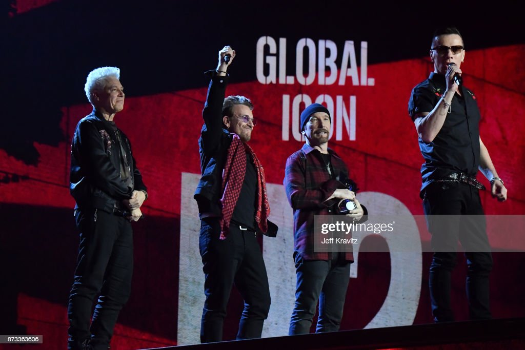 Global Icon award winners Adam Clayton, Bono, The Edge and Larry Mullen Jr of U2 are seen on stage during the MTV EMAs 2017 held at The SSE Arena, Wembley on November 12, 2017 in London, England.