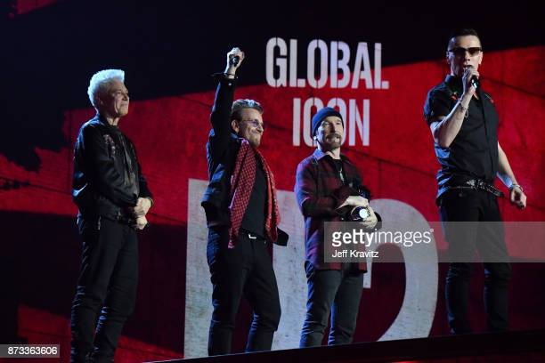 Global Icon award winners Adam Clayton Bono The Edge and Larry Mullen Jr of U2 are seen on stage during the MTV EMAs 2017 held at The SSE Arena...