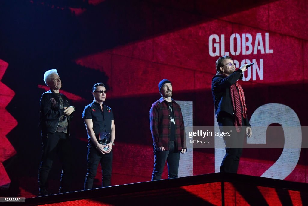 Global Icon award winners Adam Clayton, Larry Mullen Jr, The Edge and Bono of U2 are seen on stage during the MTV EMAs 2017 held at The SSE Arena, Wembley on November 12, 2017 in London, England.