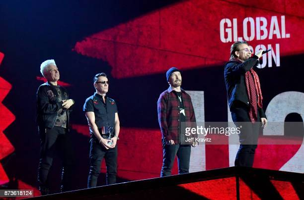 Global Icon award winners Adam Clayton Larry Mullen Jr The Edge and Bono of U2 on stage during the MTV EMAs 2017 held at The SSE Arena Wembley on...
