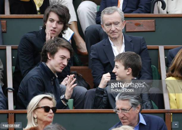 Global Luxury retailer LVMH Chairman Bernard Arnault and his sons Alexandre Frederic and Jean attend the Men's Singles final tennis match during the...