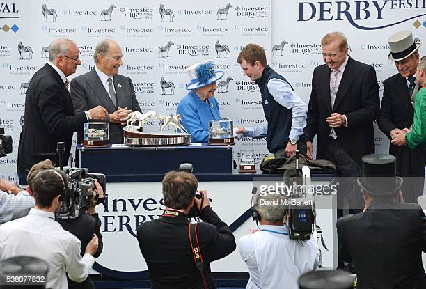 Global Managing Director of Investec Bernard Kantor His Highness The Aga Khan Queen Elizabeth II groomer Patrick Murray horse trainer Dermot Weld...