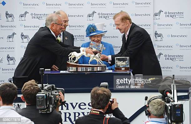 Global Managing Director of Investec Bernard Kantor His Highness The Aga Khan Queen Elizabeth II and horse trainer Dermot Weld pose in the winners...