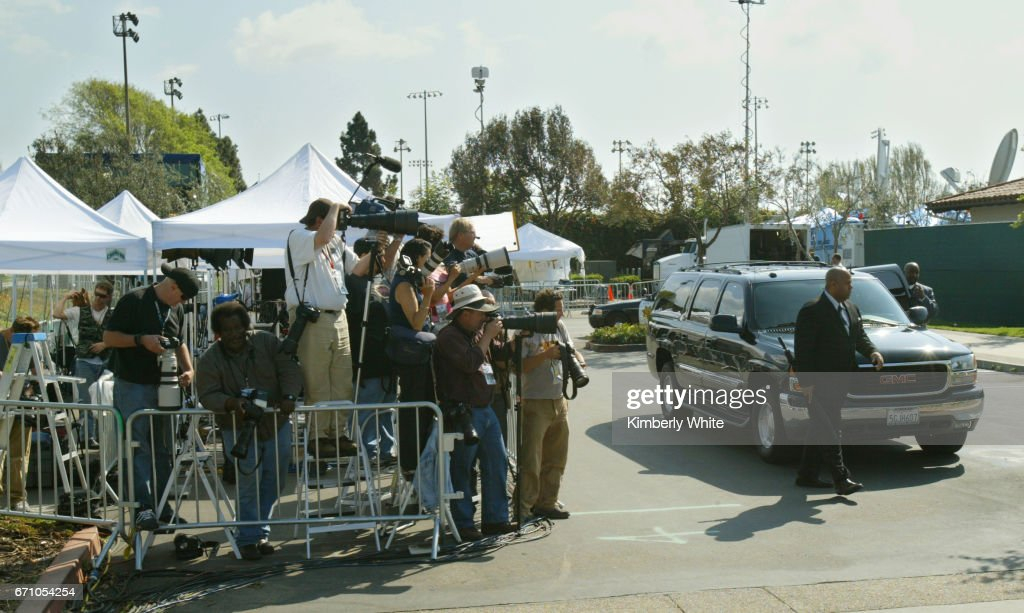 Global media work at pop singer Michael Jackson's child molestation trial as his SUV arrives to pick him up at the Santa Barbara County Court in Santa Maria.