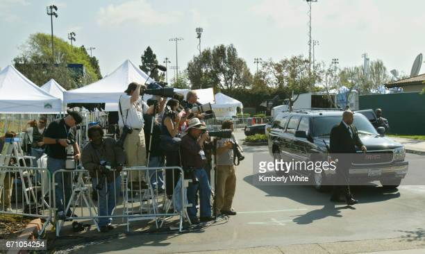 Global media work at pop singer Michael Jackson's child molestation trial as his SUV arrives to pick him up at the Santa Barbara County Court in...