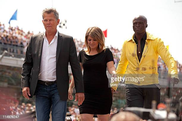 Global music superstars and Grammy Award winners David Foster Kelly Clarkson and Seal walk onto the stage to perform the national anthem during the...