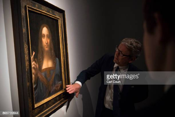 Global president of Christie's auction house Jussi Pylkkanen views a painting by Leonardo da Vinci entitled 'Salvator Mundi' before it is auctioned...