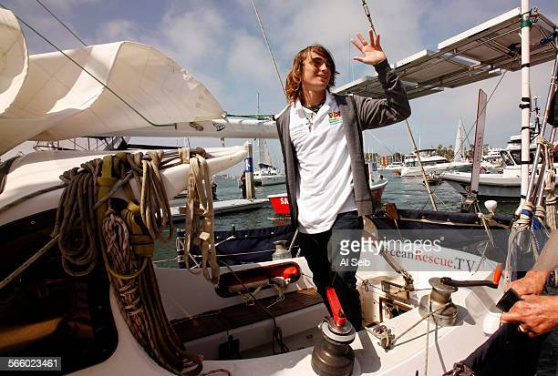 Global sailor Zac Sunderland waves to cheering crowds as he pulls into Marina Del Rey's Fisherman's Village dock Thursday morning after his 13–month...