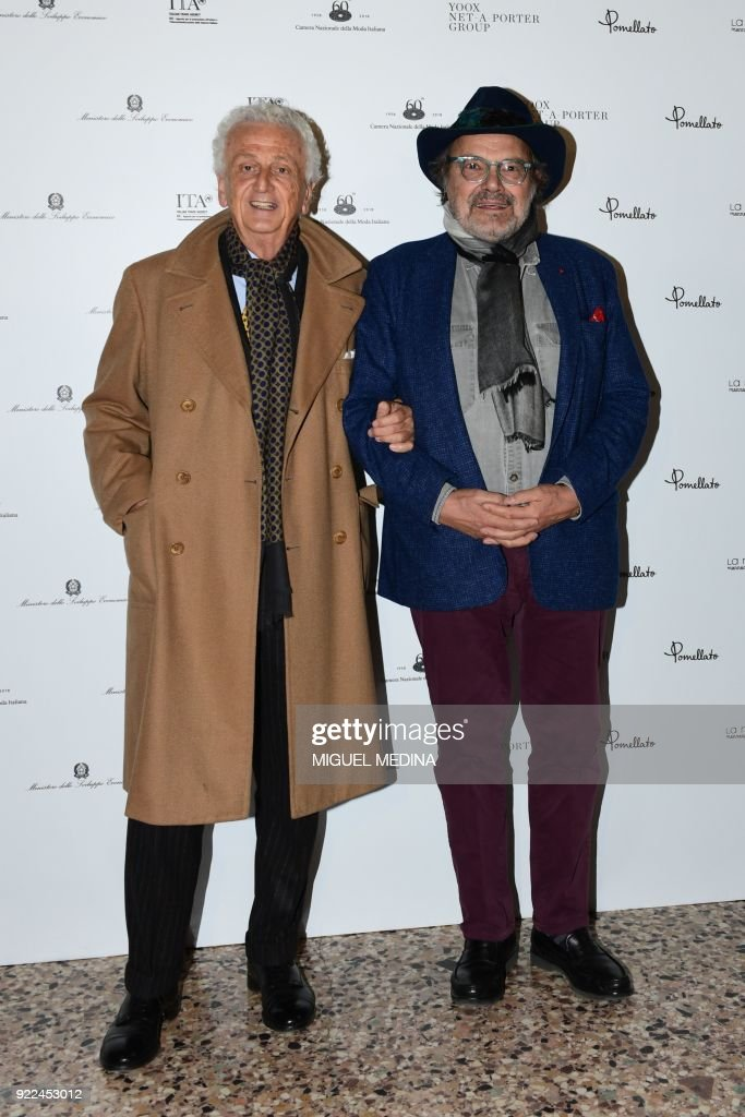 Global Strategy Advisor for The Woolmark Company Fabrizio Servente (L) and Italian photographer Oliviero Toscani pose upon the arrival to the exhibition preview of 'Italiana, Italy Through the Lens of Fashion' at Palazzo Reale in Milan, on February 21, 2018. / AFP PHOTO / Miguel MEDINA