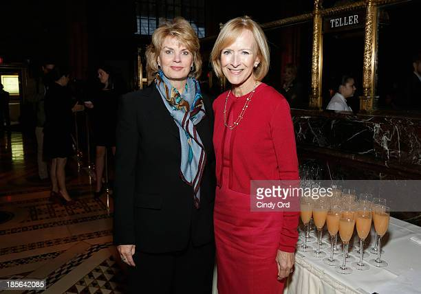 Global strategy and marketing officer Bank of America Anne Finucane and Managing Editor at PBS NewsHour Judy Woodruff attend International Women's...