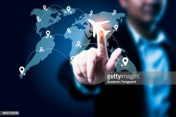 global transportation and technology communications background,  businessman touching a button on a screen with icons about travel planning, global network connection concept - multimedia stock pictures, royalty-free photos & images