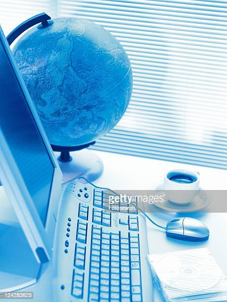 Globe and computer, High Angle View, Toned Image