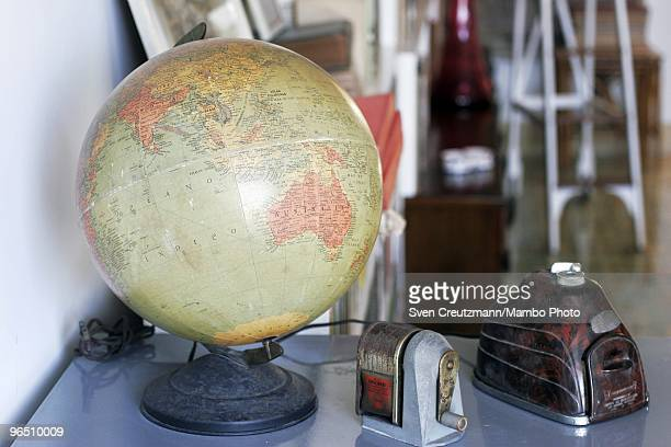 A globe and office utilities stand on a table in Ernest Hemingway�s house at the Finca Vigia on January 6 2007 in Havana Cuba The Hemingway Finca...