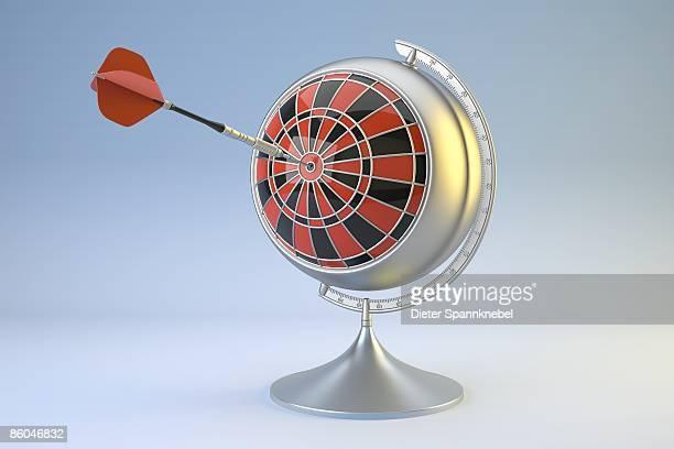 Globe as a target of a dart arrow