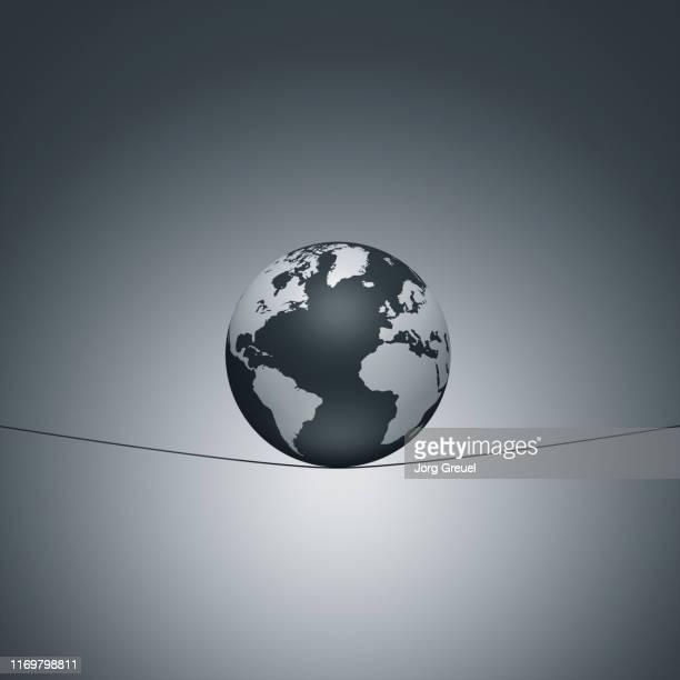 Globe balancing on a string