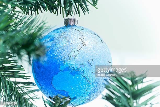 Globe bauble on christmas tree