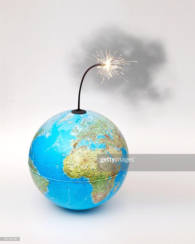 Globe bomb with smokey lit fuse on white background : Stock Photo