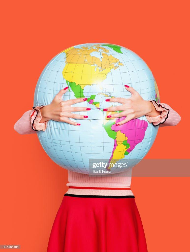 Globe Hugger : Stock Photo