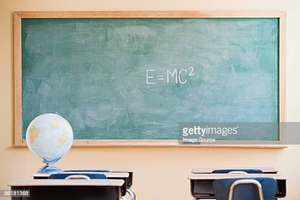 globe in a classroom - chalkboard stock photos and pictures