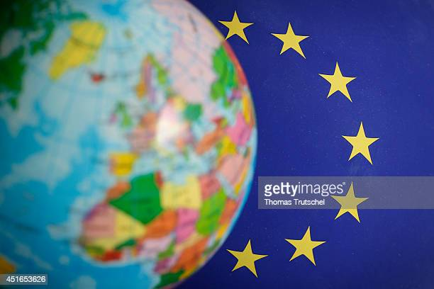 Globe in front of the flag of the European Union on July 02 in Berlin Germany