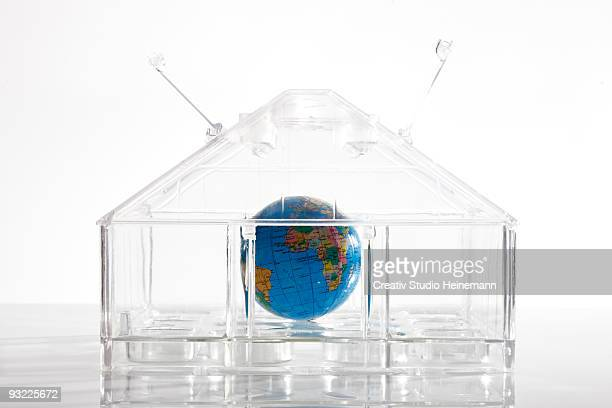 Globe in glass house, close-up