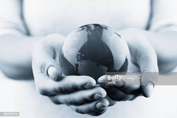 globe in hands - global village stock pictures, royalty-free photos & images