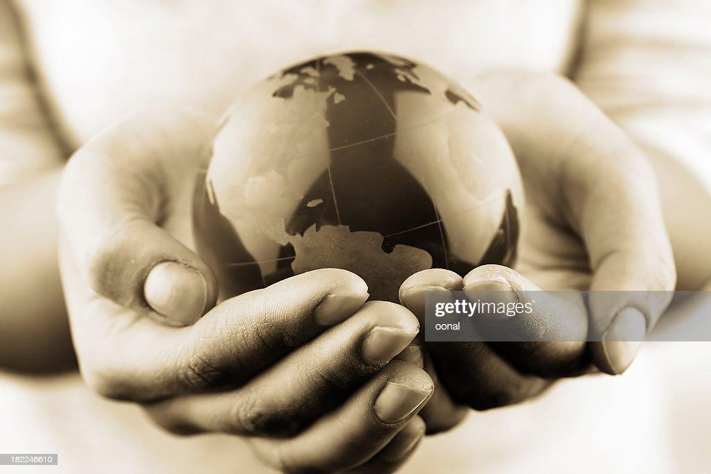 Globe in hands : Stock Photo