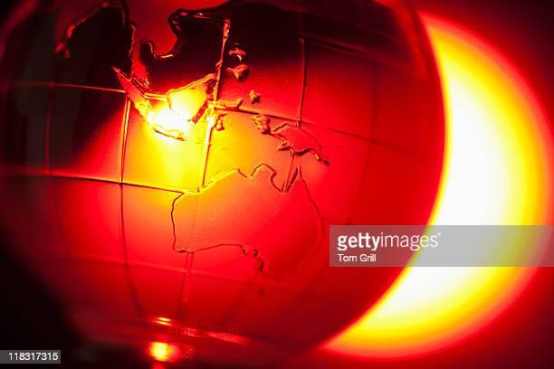 Globe in red light