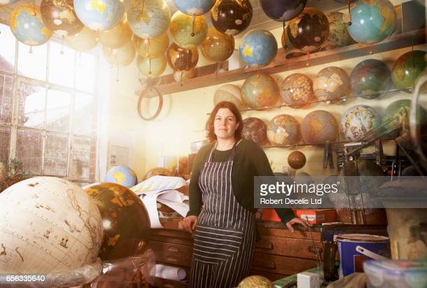 globe maker in busy work shop - craftsperson stock pictures, royalty-free photos & images