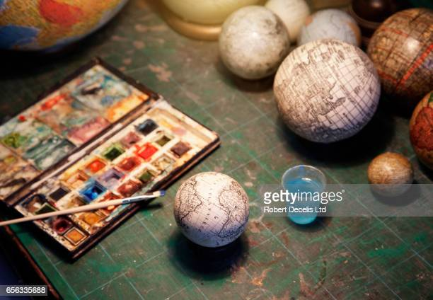 globe makers pallette of paints and brush with globes - craft stock pictures, royalty-free photos & images