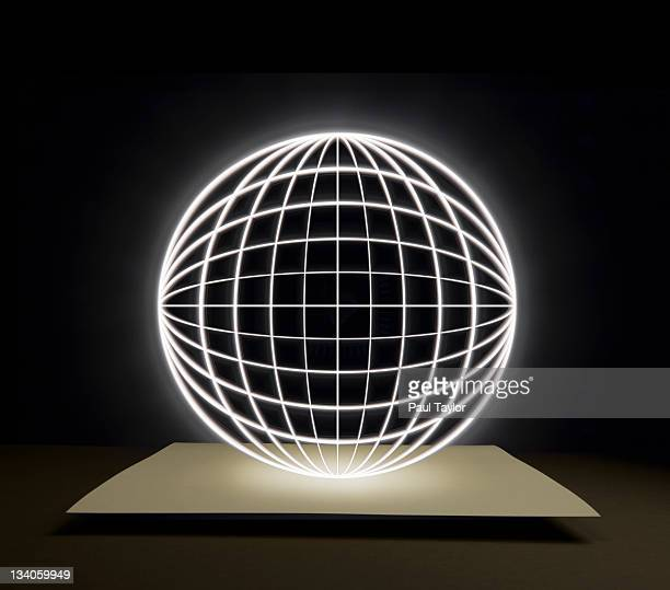 Globe of Light Over Paper