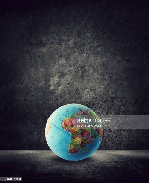globe on ground with africa on map - europa kontinent stock-fotos und bilder