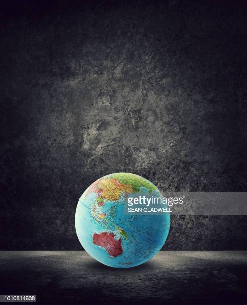 globe on ground with australia on map - europa continente foto e immagini stock
