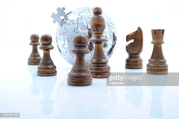 Globe puzzle and chess pieces