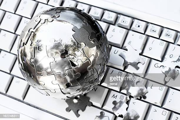 Globe puzzle on computer keyboard