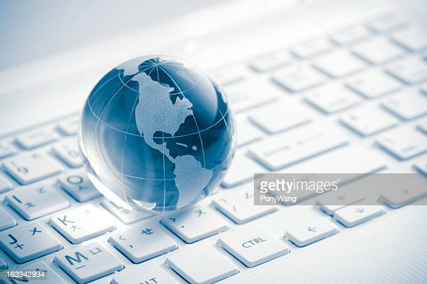 globe showing americas on white keyboard - computer keyboard stock pictures, royalty-free photos & images