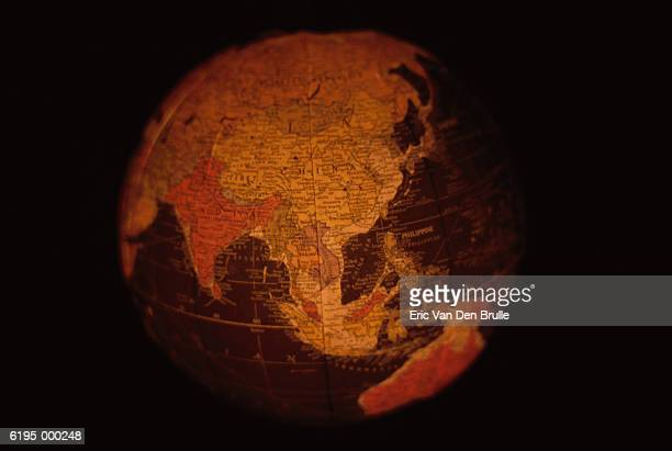 globe showing asia - eric van den brulle stock pictures, royalty-free photos & images